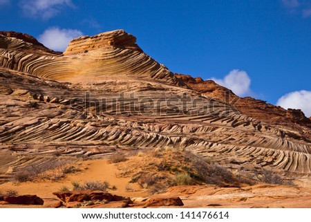 Waves of red rock in the wilderness of Utah - stock photo