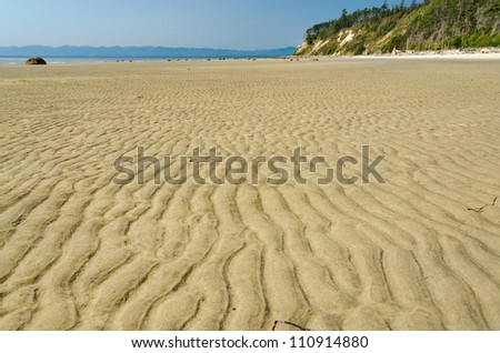 Waves of the sand on the beach in Vancouver, Canada. - stock photo