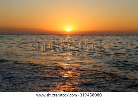 Waves of the sea, illuminated by sunlight at sunset. Costa del Sol (Coast of the Sun), Malaga in Andalusia, Spain  - stock photo