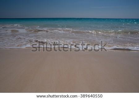 Waves on a tropical beach - stock photo