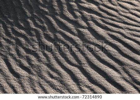 Waves on sand dunes, black and white version - stock photo