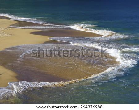 Waves on sandy beach, San Sebastian, Spain. - stock photo