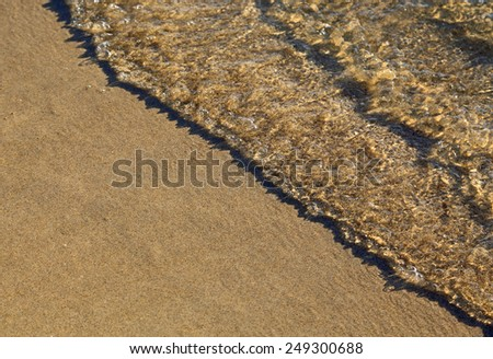 Waves on the beach close up - stock photo