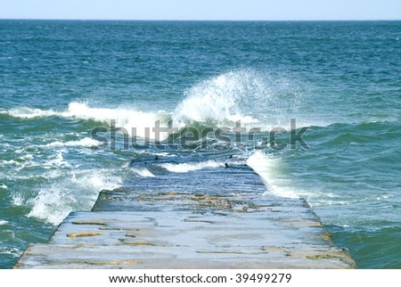 waves on the pier in the sea