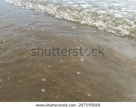 waves on the sand, gap insert text