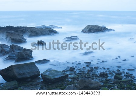 Waves on the sea coast at night