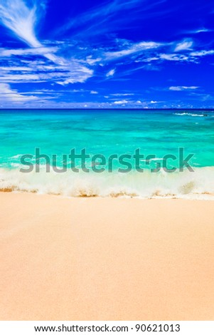 Waves on tropical beach - abstract nature background - stock photo