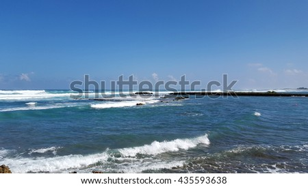 Waves roll into Kuilima Cove on the North Shore of Oahu, Hawaii.          - stock photo