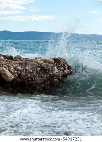 Waves strike the shore in sunny Croatia - stock photo