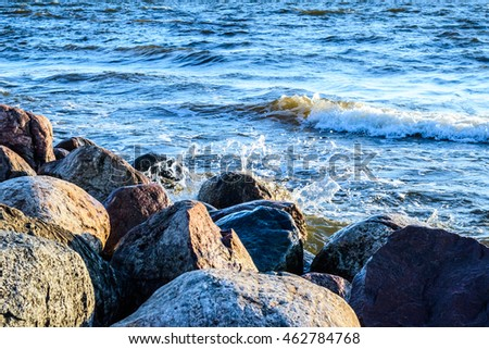 Waves washing a rocky coast at Baltic sea