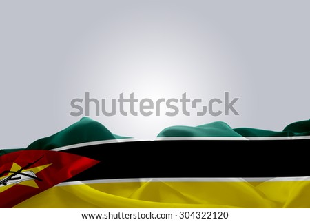waving abstract fabric Mozambique flag on Gray background - stock photo