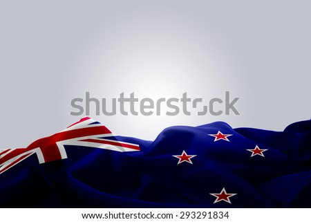 waving abstract fabric New Zealand flag on Gray background - stock photo