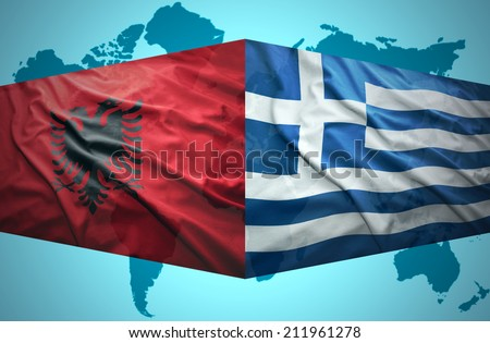 Waving Albanian And Greek Flags Of The Political Map Of The World