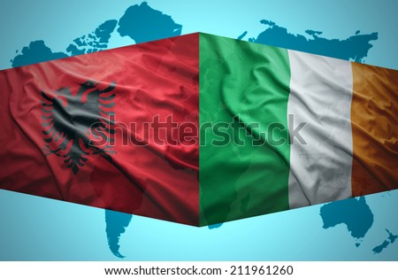 Waving Albanian and Irish flags of the political map of the world