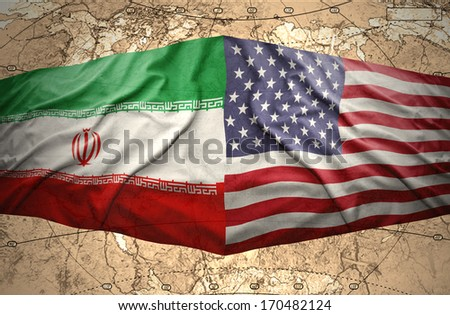 Waving American and Iranian flags on the of the political map of the world - stock photo