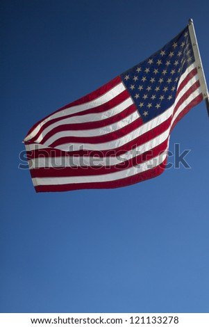 Waving American flag against cloudy sky - stock photo