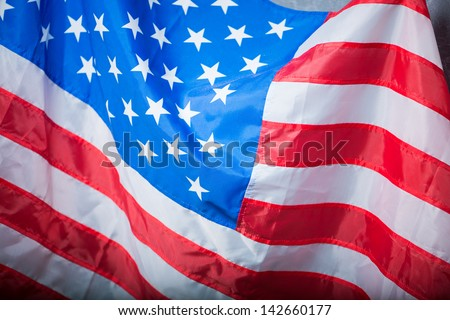 waving an American flag close up