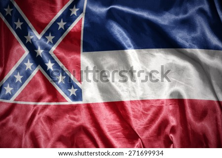 waving and shining mississippi state flag - stock photo