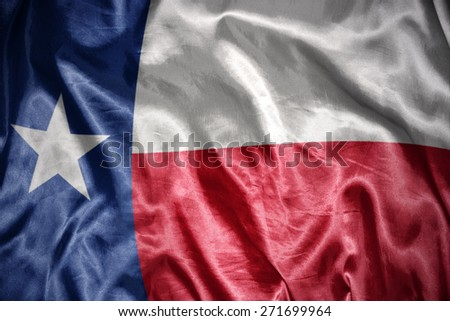 waving and shining texas state flag - stock photo