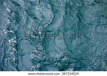 Waving, blue water surface - stock photo