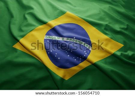 Waving colorful Brazilian flag - stock photo