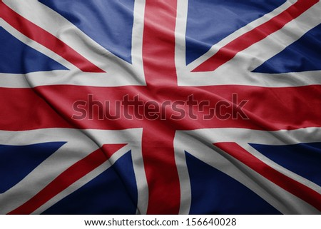 Waving colorful British flag - stock photo