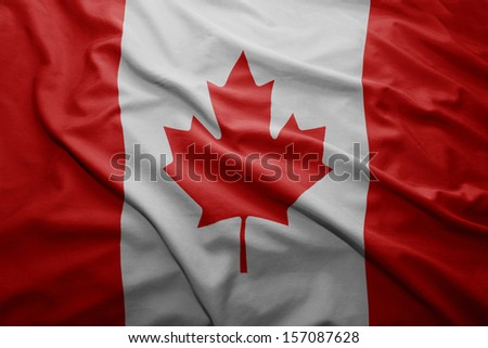 Waving colorful Canadian flag - stock photo