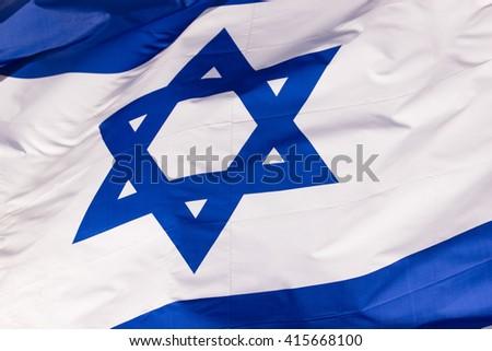 Waving colorful Flag of Israel - stock photo