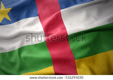 waving colorful national flag of central african republic.