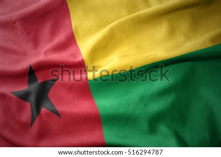 waving colorful national flag of guinea bissau.
