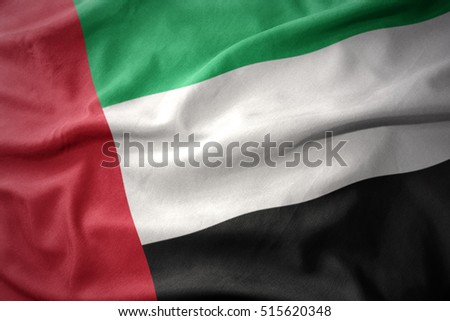 waving colorful national flag of united arab emirates.