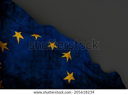 Waving dirty flag of european union with grunge texture, corner of gray background - stock photo