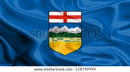 Waving Fabric Flag of Alberta, Canada - stock photo