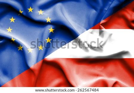 Waving flag of Austria and  European Union - stock photo