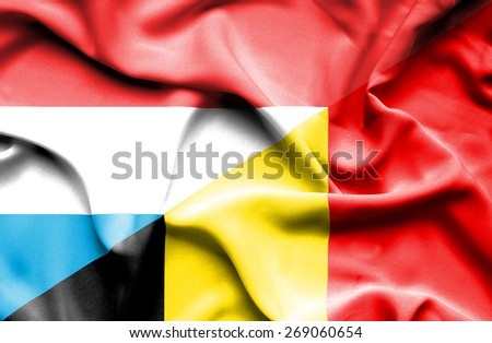 Waving flag of Belgium and Luxembourg - stock photo