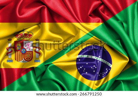 Waving flag of Brazil and Spain - stock photo