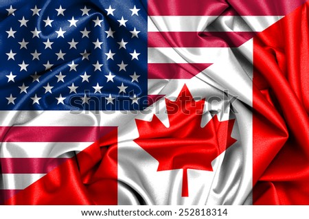 Waving flag of Canada and USA - stock photo