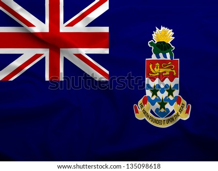 Waving flag of Cayman Islands. Flag has real fabric texture. - stock photo