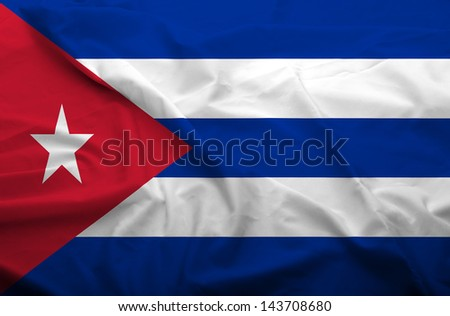 Waving flag of Cuba. Flag has real fabric texture. - stock photo