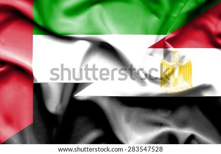 Waving flag of Egypt and United Arab Emirates - stock photo