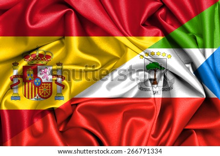 Waving flag of Equatorial and Spain - stock photo