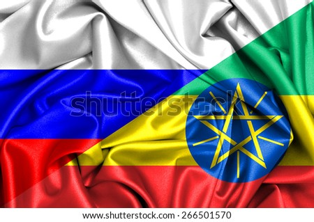 Waving flag of Ethiopia and Russia - stock photo