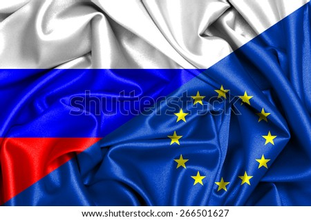 Waving flag of European Union and Russia