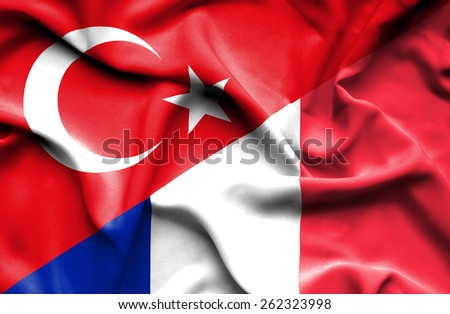 Waving flag of France and Turkey - stock photo
