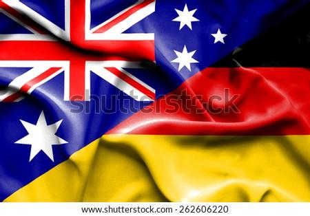 Waving flag of Germany and Australia - stock photo