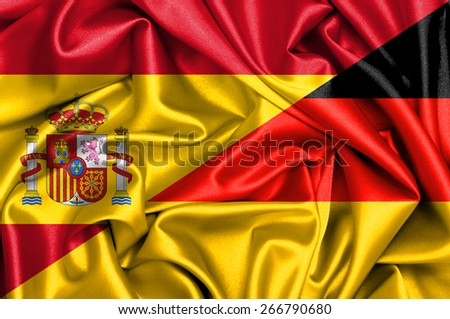 Waving flag of Germany and Spain - stock photo