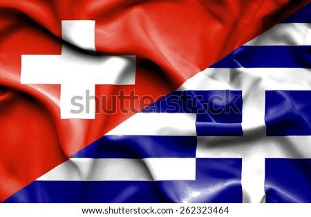 Waving flag of Greece and Switzerland - stock photo