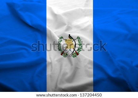Waving flag of Guatemala. Flag has real fabric texture.  - stock photo