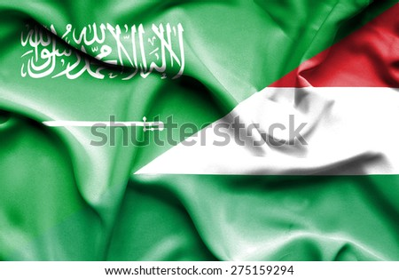 Waving flag of Hungary and Saudi Arabia