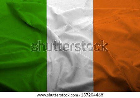Waving flag of Ireland. Flag has real fabric texture. - stock photo